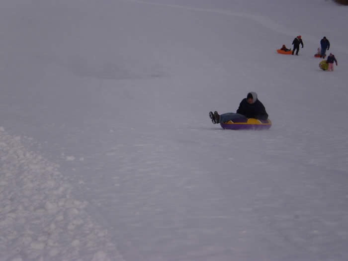 Kids tubing on hill