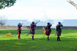 Firing muskets over Lake Ontario